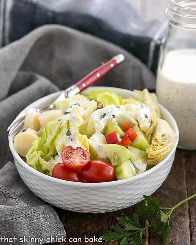 The Ultimate Ranch Dressing in white ceramic bowl with a red handled fork