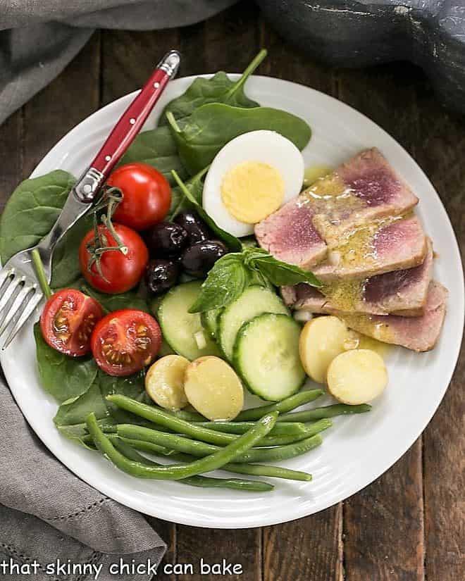 Overhead view of an Ahi Tuna Salade Niçoise on a white plate
