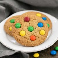 Classic M & M Cookies on a round white plate