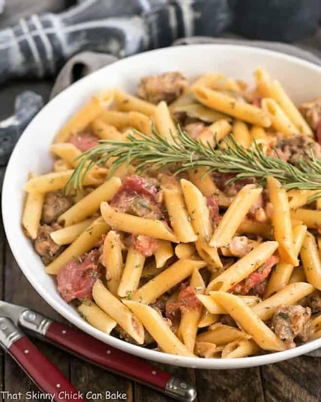 Creamy Italian Sausage Pasta in a white serving dish