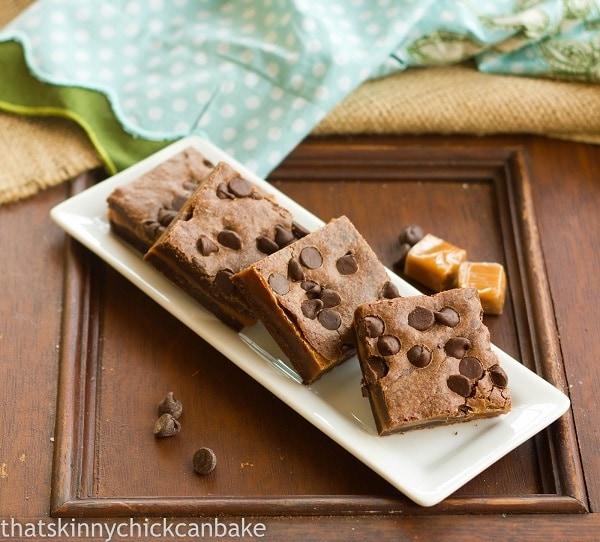 Layered Caramel Brownies  on a white rectangular tray