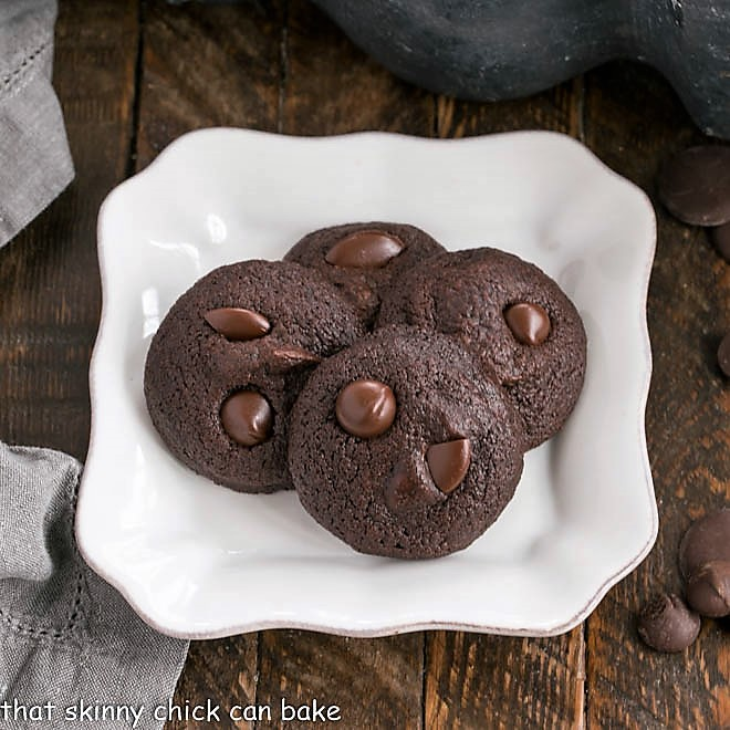Overhead view of 4 Double Chocolate Cookies on a square white plate