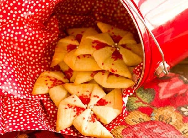 Poinsettia Cookies in a red bucket.