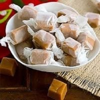 Brown Sugar Caramels wrapped in wax paper in a white bowl