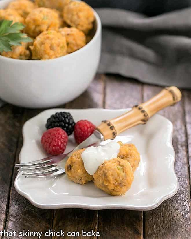 Buffalo chicken meatballs and berries on a white appetizer plate