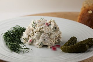 Easy Tuna Salad with Fresh Dill on a white plate with fresh dill and cornichons