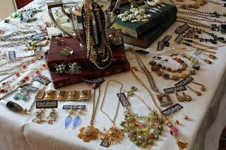 Table full of handmade jewelry