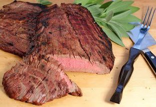 A piece of beefon a cutting board