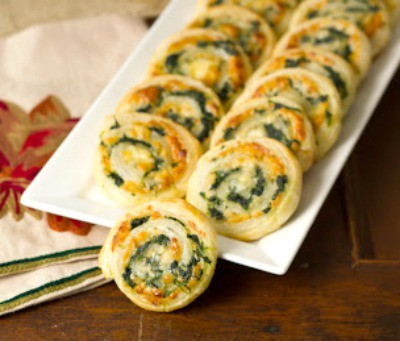 Muenster and Spinach Pinwheels on a white tray