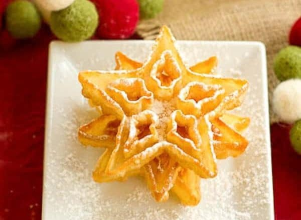Rosettes | A light, exquisite crisp deep fried holiday cookie dusted in powdered sugar