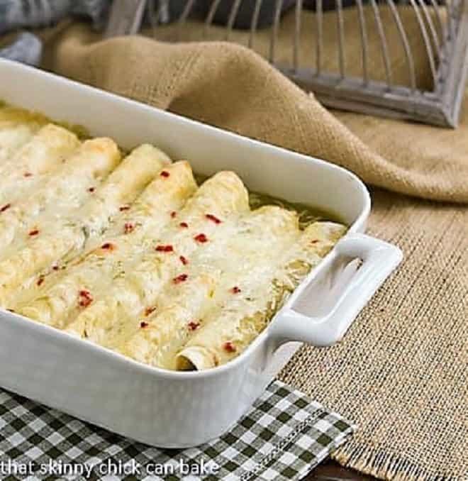 Creamy chicken enchiladas in a casserole dish