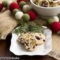 Cranberry Pistachio White Chocolate Shortbread cookies on a white plate