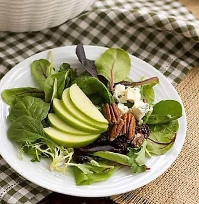 Loaded Winter Salad with Apples, Pecans, Blue Cheese and Dried Cherries on a small plate