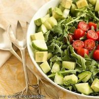 Maddy's Arugula Salad in a white ceramic serving bowl