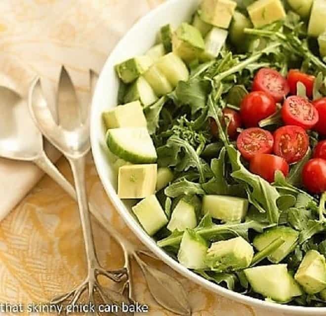 Maddy's Arugula Salad in a white ceramic serving bowl