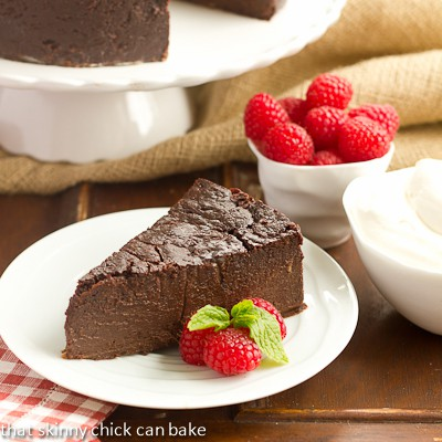 Slice of Flourless Chocolate Kahlua Cake on a white dessert plate