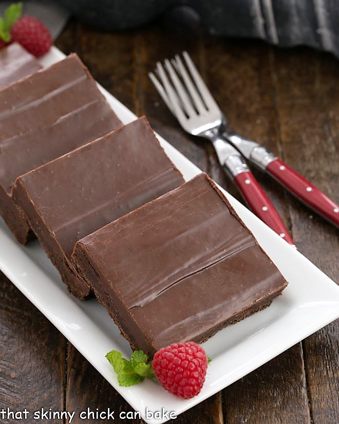 Fudge topped brownie squares on a platter