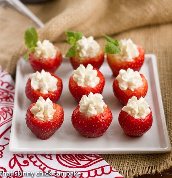 Mascarpone Filled Strawberries on a square white serving tray