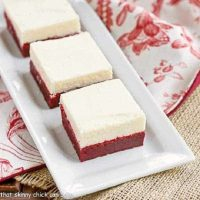 Red velvet brownies on a white tray over a red and white piece of fabric