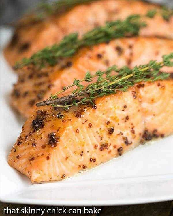 Maple Mustard Glazed Salmon fillets on a white serving tray