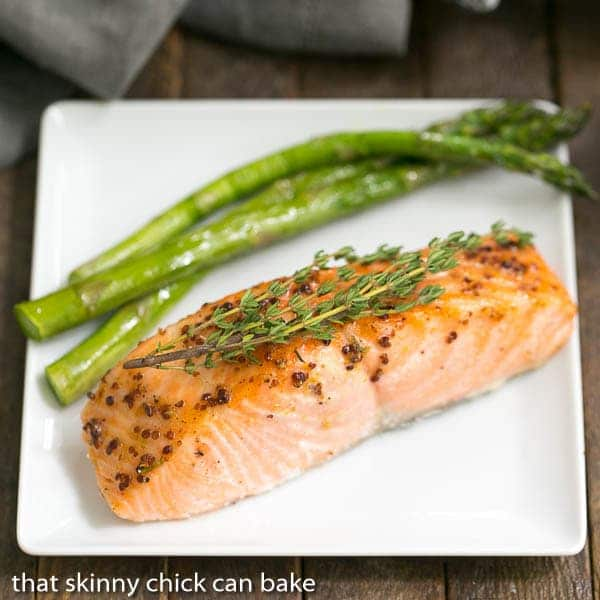Maple Mustard Glazed Salmon fillet on a white square plate