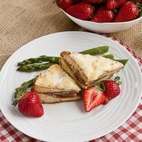 Croque Monsieur - a classic French sandwich topped with a cheese sauce