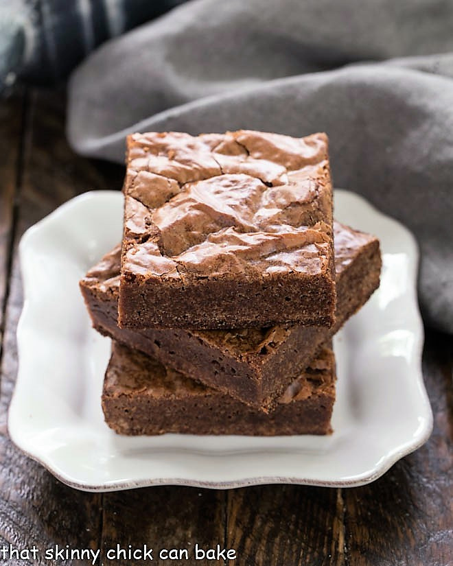 Easy Homemade Brownies stacked on a white plate