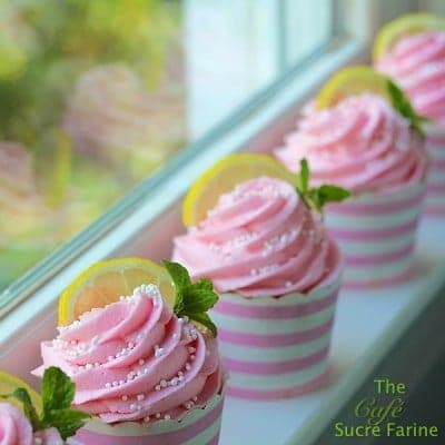 Pink Lemonade Cupcakes lined up on a window sill