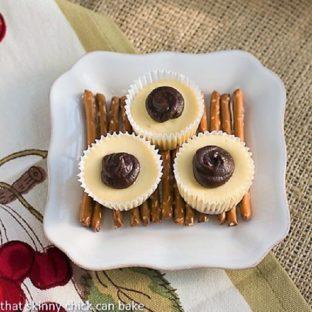 Mini Rolo Cheeseccakes on a white plate