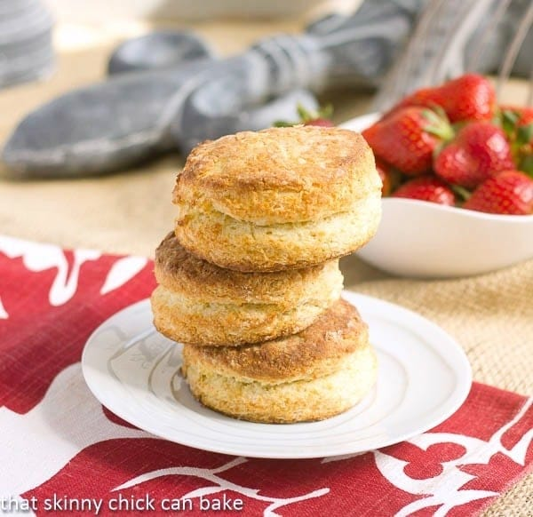 A stack of biscuits on a white plate for strawberry shortcakes