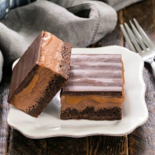 2 milky way brownies on a square white plate