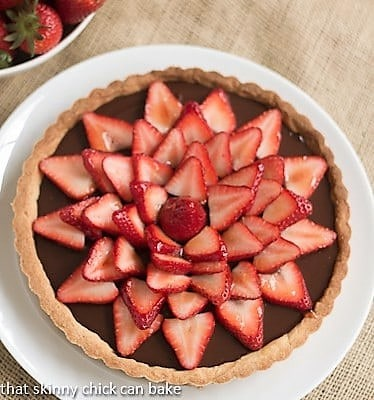 Overhead view of a Strawberry Topped Chocolate Tart on a serving plate