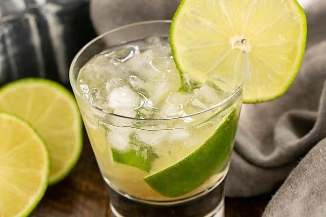 Caipirinha Cocktail in a highball glass with a lime garnish