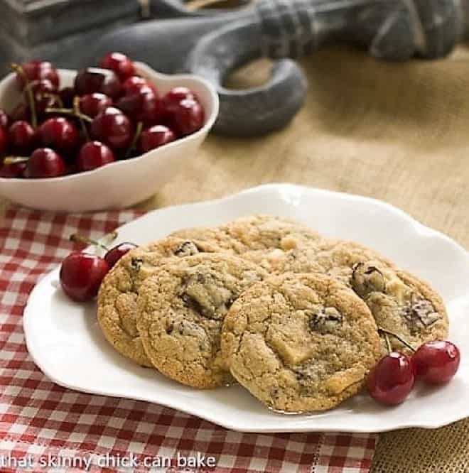 Oatmeal Dried Cherry Cookies with Chocolate Chunks on a white oval plate on a checkered napkin