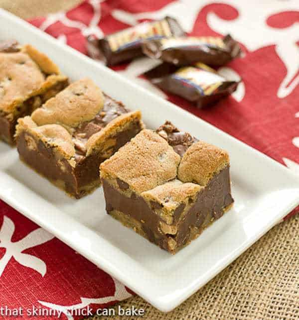 Fudge and Toffee Filled Chocolate Chip Bars on a white tray