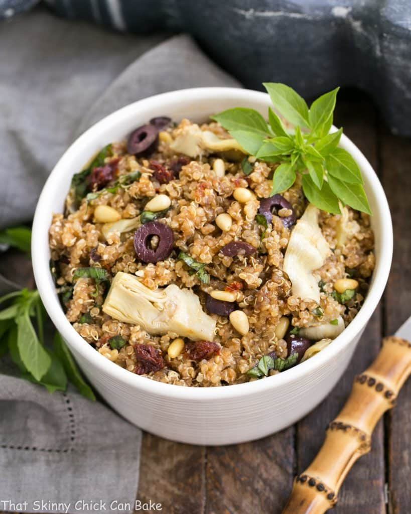 Mediterranean Quinoa Salad with Olives, Basil and Sun-dried Tomatoes | Loaded with flavor and simply dressed with olive oil and balsamic!