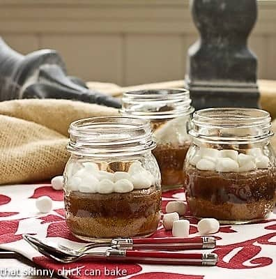 Threee S'mores Brownies in Jars  with red handled spoons