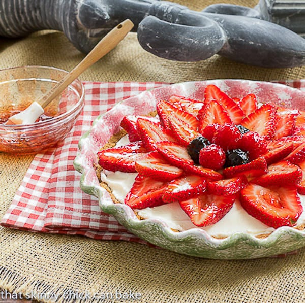 Strawberry Cream Cheese Dessert with a bowl and brush with glaze topping