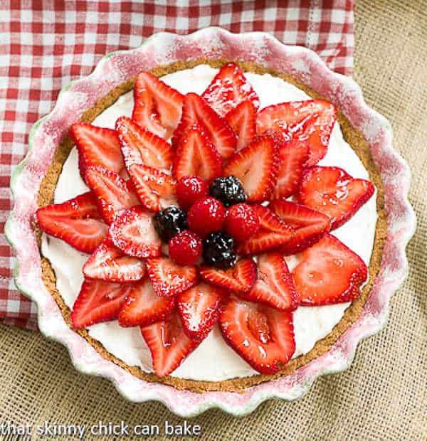Strawberry Cream Cheese Dessert | A dreamy cream cheese and whipped cream filling topped with juicy ripe strawberries!