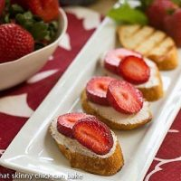 Strawberry Tartines lined up on a white platter