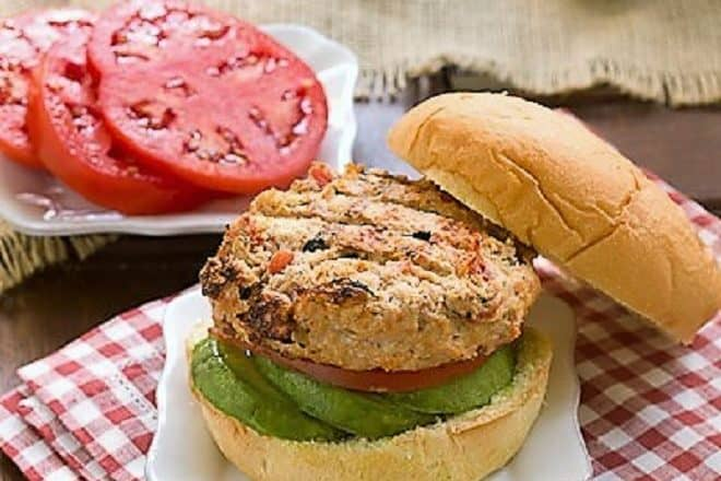 Caribbean Chicken Burger with the top bun removed