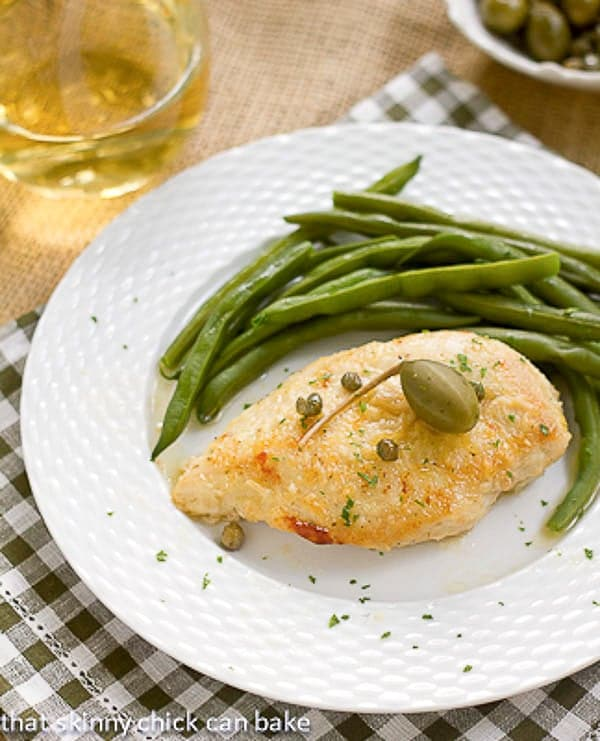 Easy Skillet Chicken Piccata on a white plate topped with capers