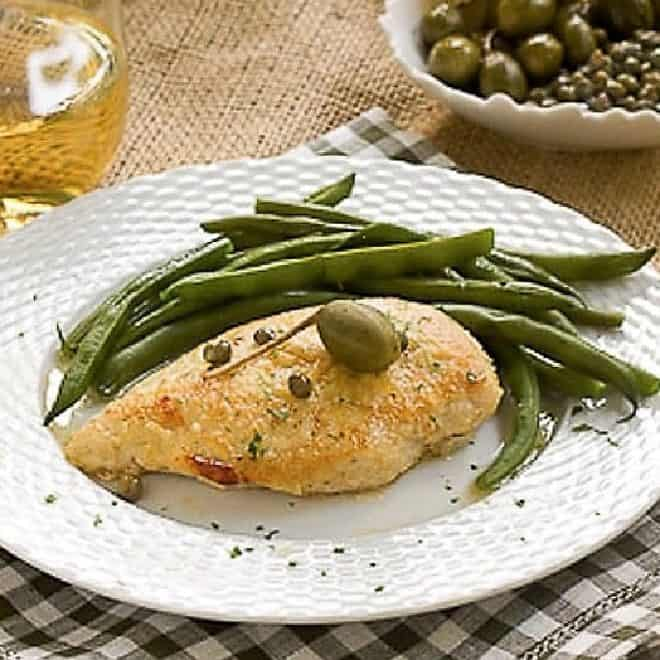 Easy Skillet Chicken Piccata on a white plate with green beans