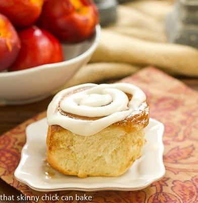 Nectarine Cinnamon Rolls on a white plate.