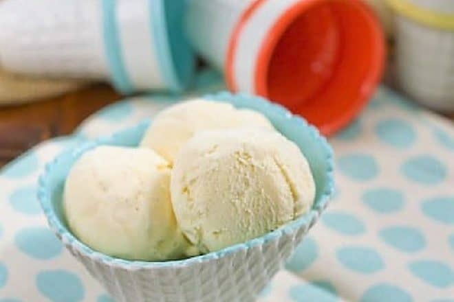 Vanilla Bean Ice Cream in a white and turquoise ice cream bowl on a polka dot napkin