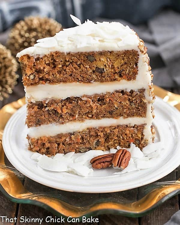 Slice of 3 Caramel Filled Carrot Cake on a white dessert plate