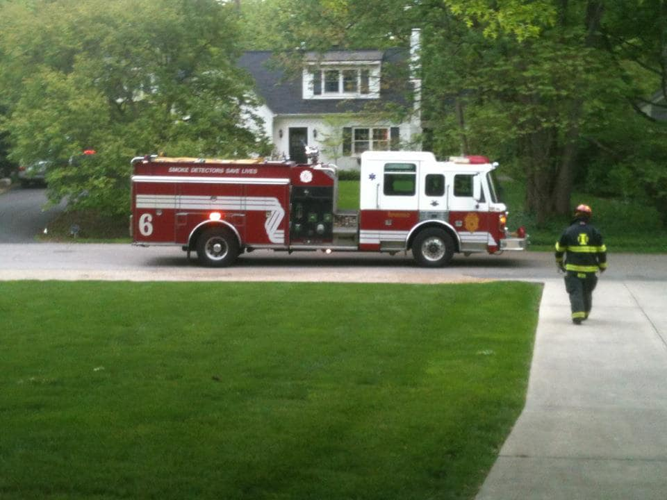 Fire truck in front of house