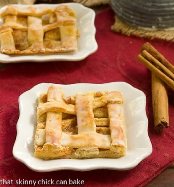 A slice of Cinnamon Apple Squares on a white dessert plate