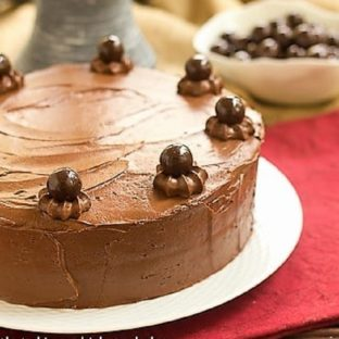 Chocolate Layer Cake on a white cake plate