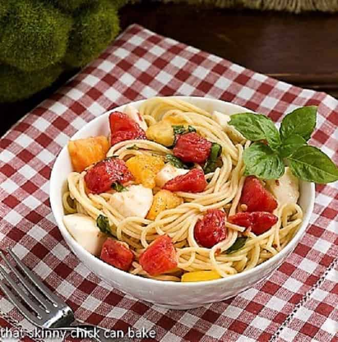 Spaghetti No-Knife in a white bowl over a red and white checkered napkin